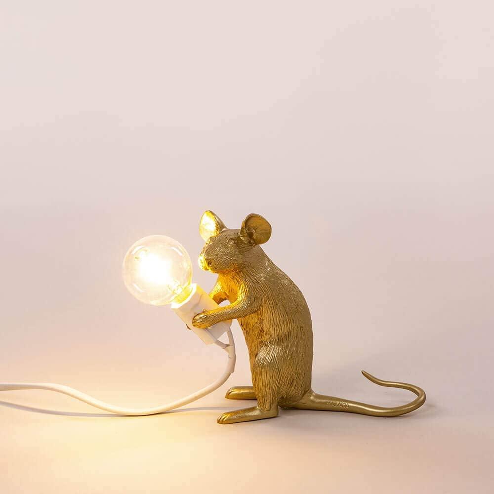 lampada topo seletti oro seduta
